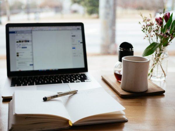 writer's retreat uk - pen laptop writing